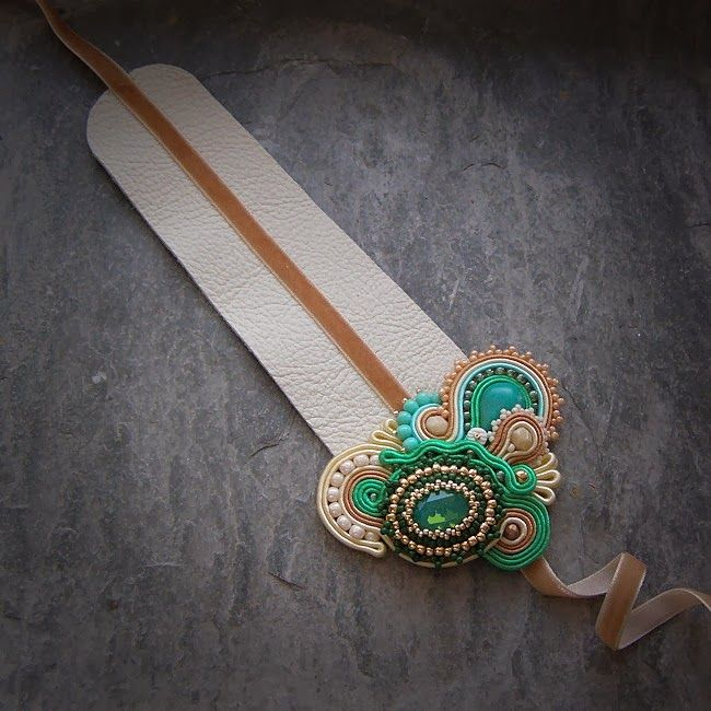 S A A D I A #soutache. This is beautiful, love use of ribbon as tie on leather cuff element...soutache...colors....lovely!
