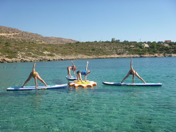 Early morning class at Loutraki beach, Chania Crete on our Mistral boards.  http://paddleboardyoga.net/