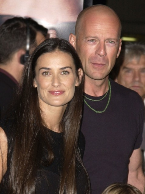 """Demi Moore & Bruce Willis  Before David Arquette and Courteney Cox joined the ranks of the happily divorced, Demi Moore, 49, and Bruce Willis, 57, were the former marrieds who set the bar highest for ex-spouse harmony. For years, the sight of Bruce and Demi (pictured at an L.A. premiere on Oct. 4, 2001) grinning on the red carpet alongside their three daughters and Ashton Kutcher was such a common occurance that it practically got boring (but in a good way). """"I love Demi,"""" Willis told GMA.."""