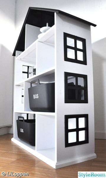 Build a dollhouse with a big enough rooms to hold storage boxes with the dolls and furniture when not in use.