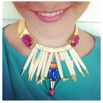 A sneaky shot of Lani Holmberg wearing her Caprica necklace