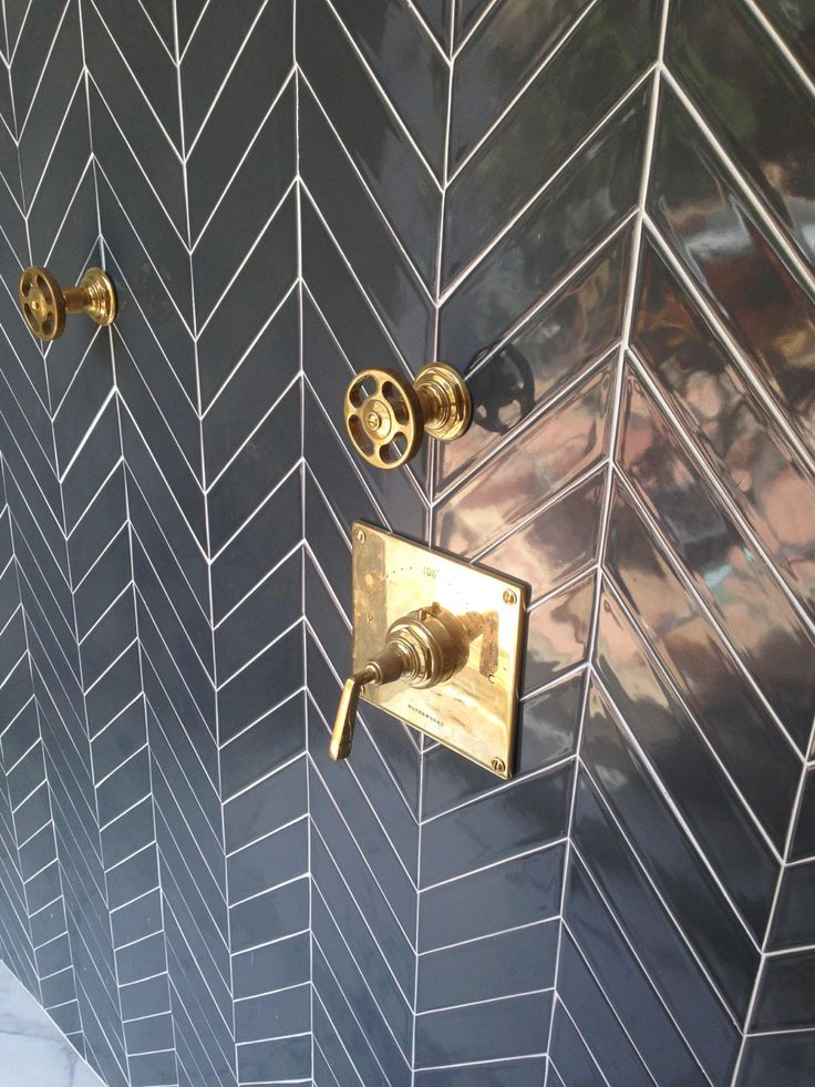 """Kiln American made ceramic Chevron tile in Carbon highlights a """"Hollywood Glam"""" shower. www.modwalls.com"""
