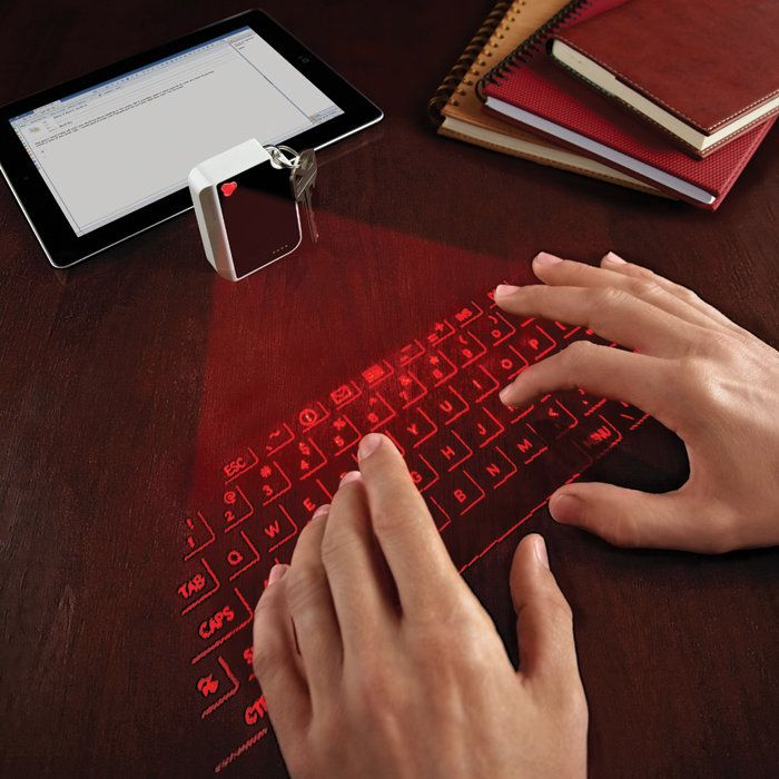 Finally-room enough for my coffee and to type in my fave cafe!!!  A virtual -laser- keyboard that connects via bluetooth and pairs with smartphone, laptop or tablet!  $99.99