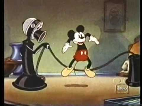 Through The Mirror. Through the Looking Glass with Micky Mouse as Alice. Disney cartoon probably made in the 30's. Fun!