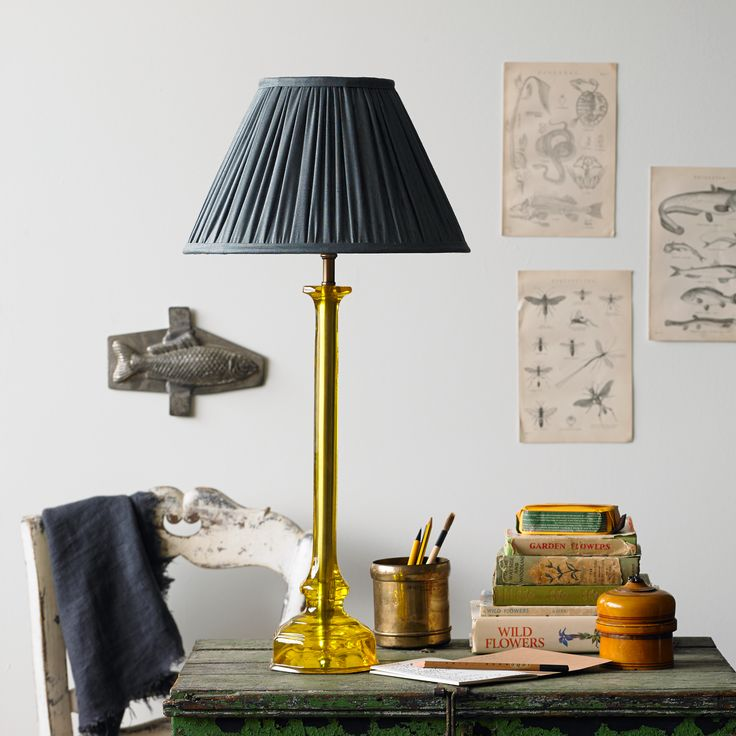 Oralee table lamp in yellow lighting with green hand blocked shade base pooky