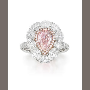 A coloured diamond and diamond ring The pear-shaped modified brilliant-cut fancy light brownish pink diamond, weighing 1.21 carats, within a brilliant-cut pink hue diamond surround, to an oval-cut and heart-shaped colourless diamond surround and single-cut diamond half-hoop, mounted in 18k white gold, the remaining diamonds estimated to weigh approximately 2.90 carats in total