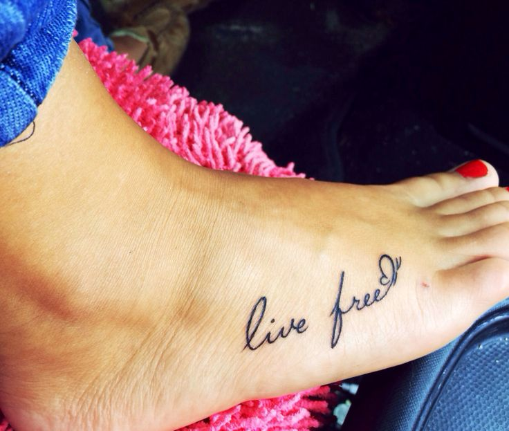 """Finally got my foot tattoo! It says """"live free"""" with a butterfly at the end. I love it so much!"""