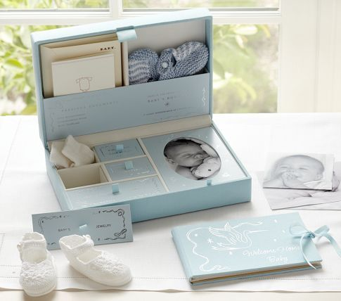 Baby Cloth Box from Pottery Barn Kids - I don't usually like memory boxes but this one is really adorable! and sold out. :(  But maybe a DIY idea.