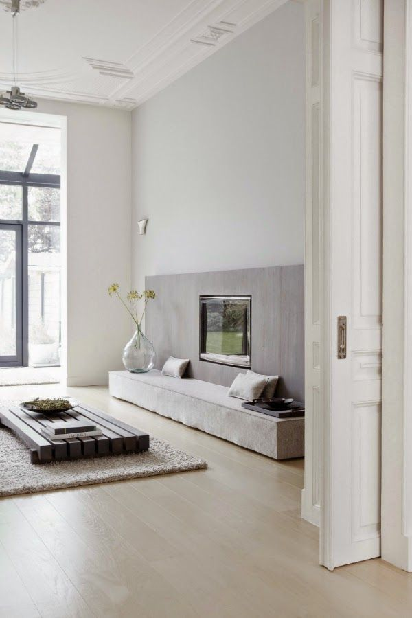 Tranquil grey living room. Fireplace. Minimalist. Modern. Concrete. Wood. Asian. Decor. Interior Design. High Ceilings. Sliding Door.