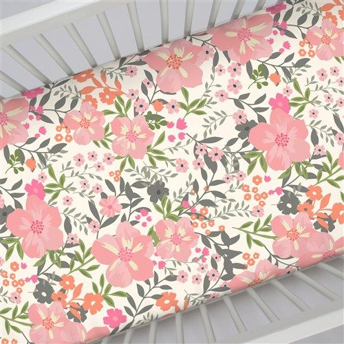 "Crib Fitted Sheet in and Pink and Orange Floral Tropic by Carousel Designs.  Our fitted crib sheets feature deep pockets and have elastic all the way around the edges to hug mattresses securely. Fits standard crib mattresses, measuring approximately 28"" x 52""."