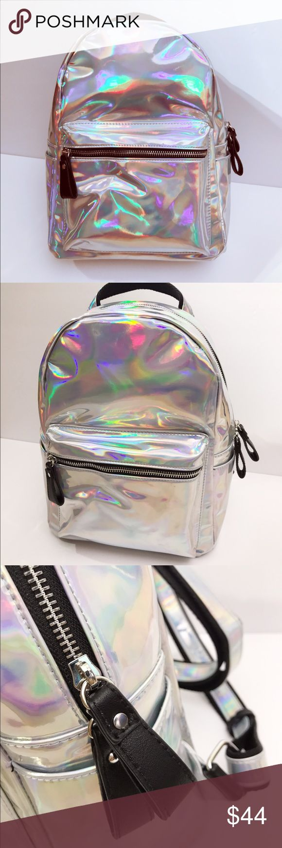 """Holographic Structured Small Backpack Trending holographic structured small backpack. Unleash your inner unicorn spirit animal 🌈🦄. Interior is black with two compartment pockets, rimmed with holographic print. Adjustable straps. 10"""" L x 13.5"""" H x 4"""" W. Bags Backpacks"""