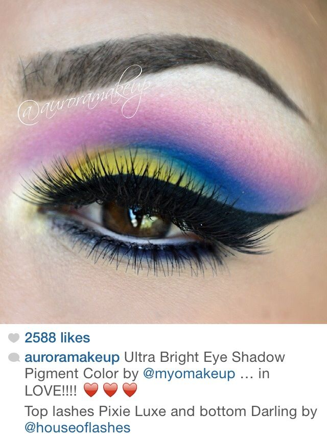 Colorful eye shadow with winged eyeliner by @auroramakeup. Pretty eye makeup for brown eyed girls.