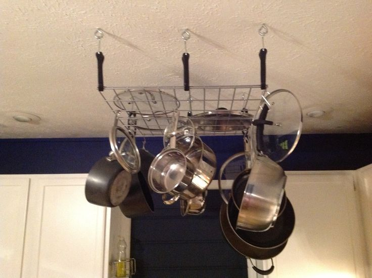 eye hooks for hanging. diy hanging pot rack under $15. eye hooks, bungee cords, and storage shelf hooks for