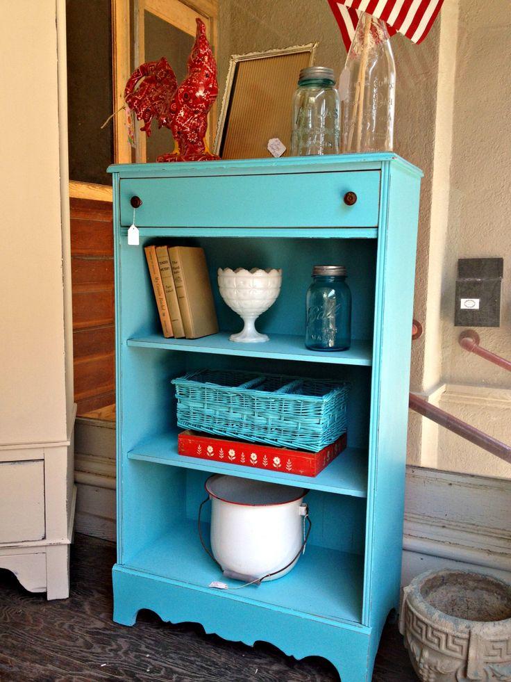 """Darling vintage bookshelf painted in """"Sea Glass"""" by Mother Earth Paints."""