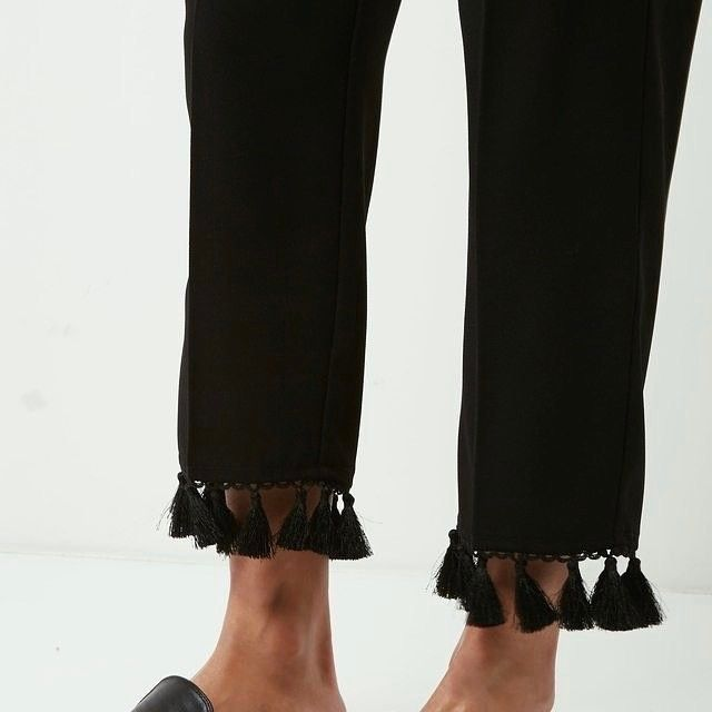 We call these our party pants. Tassel Trim Trousers. ✔ Ultra comfy + fun. Trendy pants never felt so good. Tap on the link in our bio + receive 15% off first time shopping.
