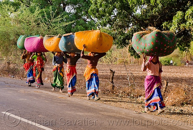 people carrying things on their heads