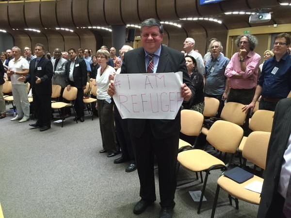 Otniel Bunaciu, president of the European Baptist Federation and a Romanian theologian, holds us a sign at the end of sermon, preaching during the opening session of the EBF's 2015 council meeting in Sofia, Bulgaria. Photo by Nabil Costa.