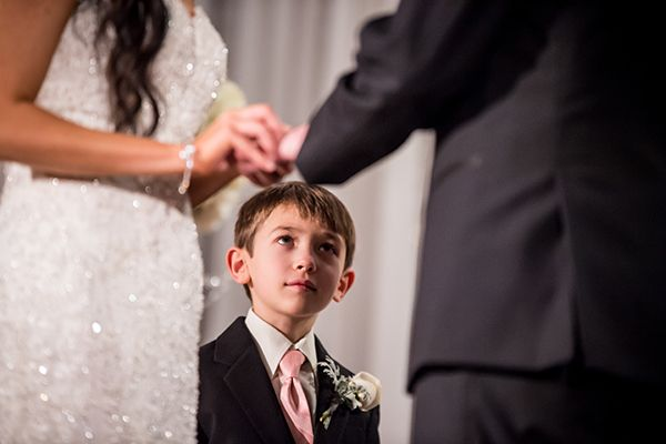 A ring bearer contemplates the meaning of marriage in this stoic snapshot.