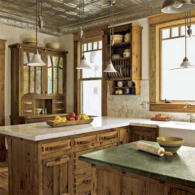 Handcrafted oak cabinets with walnut accents and tin ceiling restore beauty to this battered bungalow.   Photo: Deborah Whitlaw Llewellyn   thisoldhouse.com