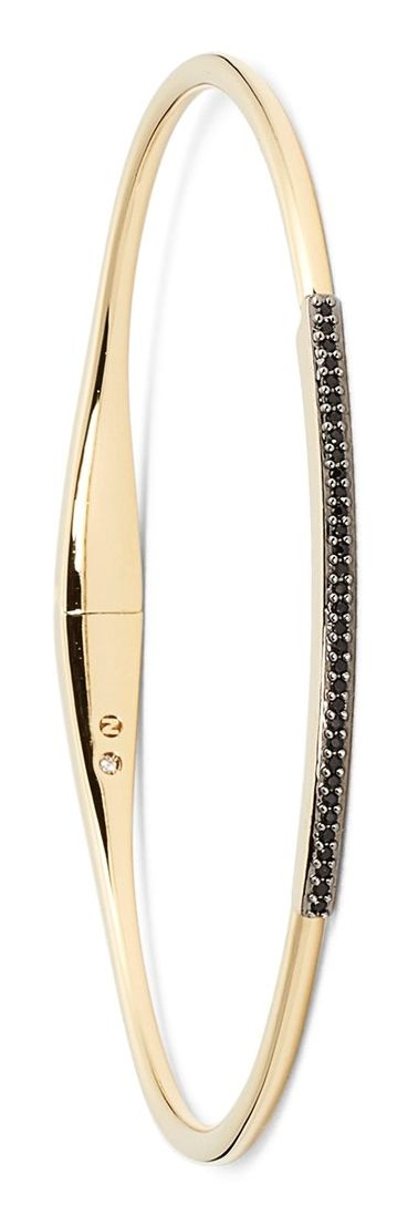 Love the sparkling line of black crystals on the top of this skinny, stackable gold bracelet.