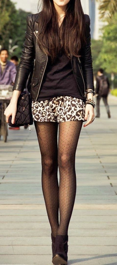 Shop this look on Lookastic: https://lookastic.com/women/looks/biker-jacket-v-neck-t-shirt-mini-skirt-ankle-boots-tights/3963 — Black Leather Biker Jacket — Black V-neck T-shirt — Tan Leopard Mini Skirt — Black Tights — Black Suede Ankle Boots