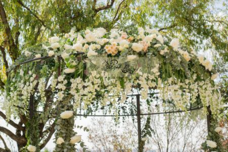 Dome canopy for outside ceremony covered in flowers. Magical - Floral Design & Decor by www.pinkenergyfloraldesign.co.za