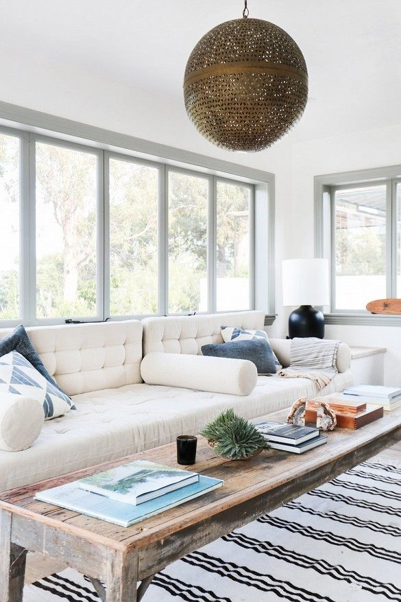 Moroccan light fixture in white living space with tufted sofa