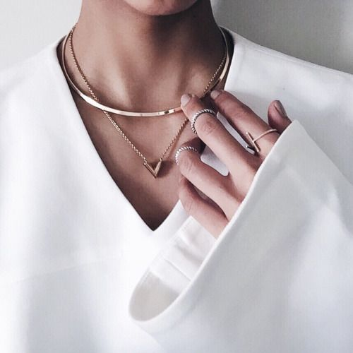 white blouse, layered necklaces, layered rings