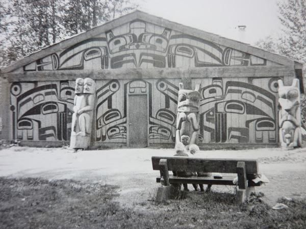 Gitksan, Ksan village reconstruction. Left: Split being post or Double-headed person on a housepost at 'Ksan reconstructed village by Able Campbell; NMC L.O.54847. Centre: Beaver House post Left: Wolf House post