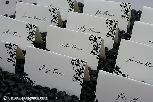 black and white damask place cards...love the idea of the black beans holding the cards in place...also printing the words related to marriage to coincide with the table cards.