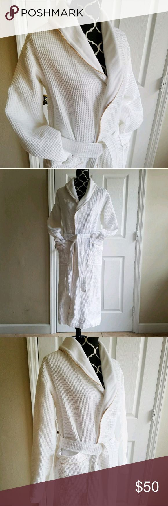 Banana Republic bath robe size XS/S Bathrobe from Banana Republic, white and textured with a terry cloth lining - ir is in good used condition, has recently been cleaned and has no rips, stains, tears or odors.?It has two front pockets and a sash to tie it closed. The pockets and the front opening are both lined with a gold colored accent.?  Measurements are:  Total length: 43 inches  The outside sleeve (from shoulder to wrist) is 23 inches The inside sleeve (from underarm to wrist) is 20…