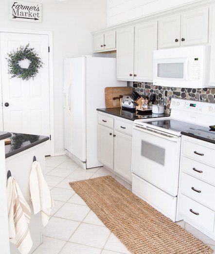 White Kitchen With River Rock Backsplash
