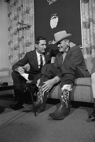 "Alabama head coach Paul ""Bear"" Bryant turned the tables on his Cotton Bowl rival. Texas A & M head coach Gene Stallings by showing up at a joint press conference wearing a pair of ""Texas Aggies"" cowboy boots. Bryant was given the boots by an alumnus when he was head coach at Texas A & M, after his 1956 Aggie team won the Southwest Conference championship. Stallings played for Bryant on that team and was later an assistant coach at Alabama for Bryant before taking the A & M head coaching job."