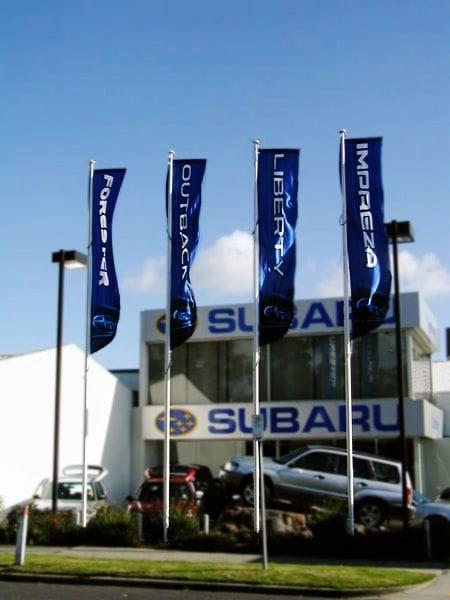 Custom flags on flag poles for an automotive company.