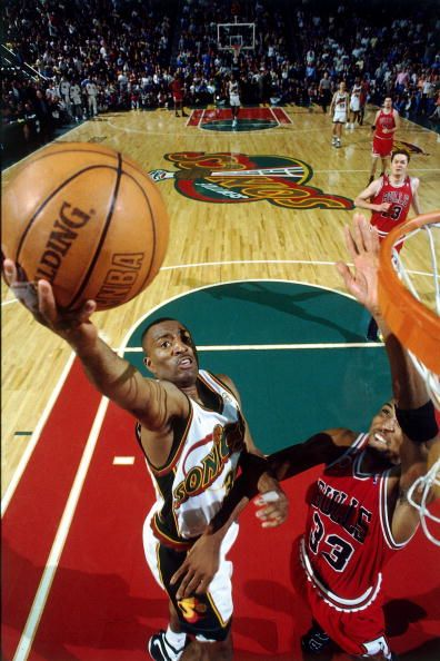 Hersey Hawkins of the Seattle SuperSonics shoots a layup against Scottie Pippen of the Chicago Bulls in Game Four of the 1996 NBA Finals at Key Arena...