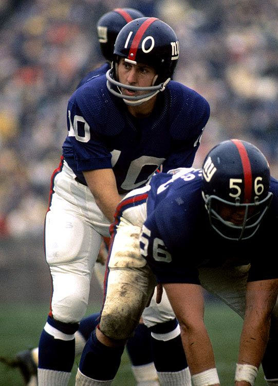 Fran Tarkenton #10 (QB) barks out the play call behind his offensive line.  Hall-of-Famer and nine-time Pro Bowl selection.