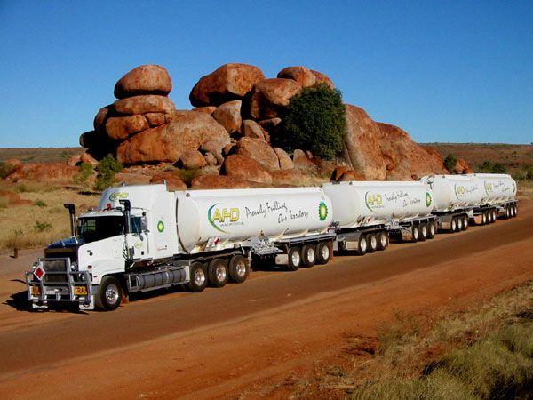 """road train (Northern Territory Australian) """"Shucks, ain't a 'heap a' corners out daahr anyhows!!"""