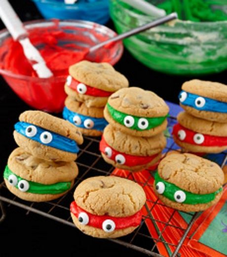 Ninja Turtles Chocolate Chip Cookies Recipe   I would make a basic sugar cookie recipe dye it green and use frosting on inside with correlating colors, (Red purple blue orange)
