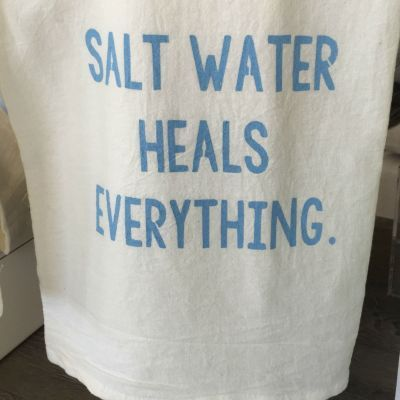 SALT WATER HEALS EVERYTHING. is the message printed on these white flour sack towels.  Use in the kitchen or bathroom and treat your guests to these wise words.  Makes a great gift!