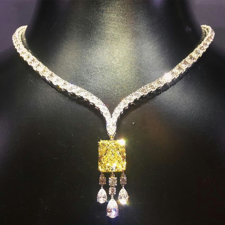 RonaldAbram Pear Shape Diamond Necklace featuring a 9.04 carat Fancy Yellow Diamond Pendant