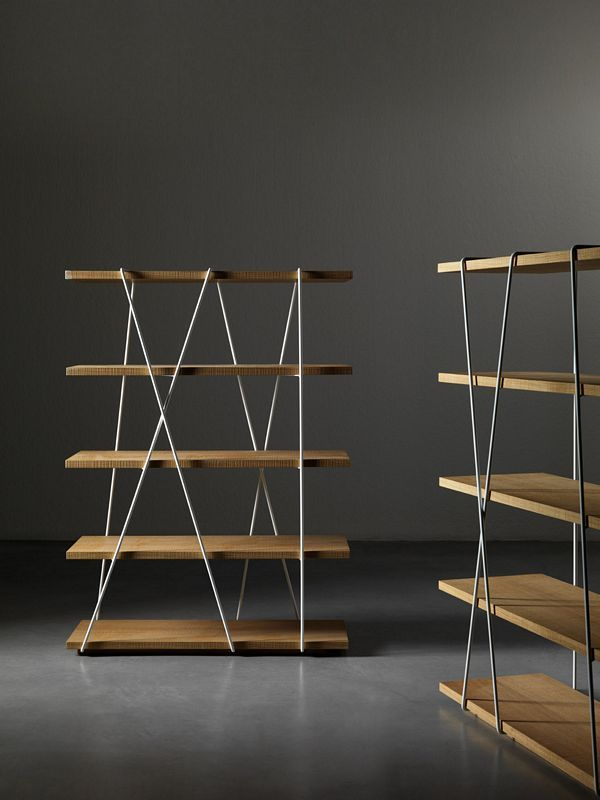 Design: Luigi Semeraro. Library with shelves in wood or lacquered.