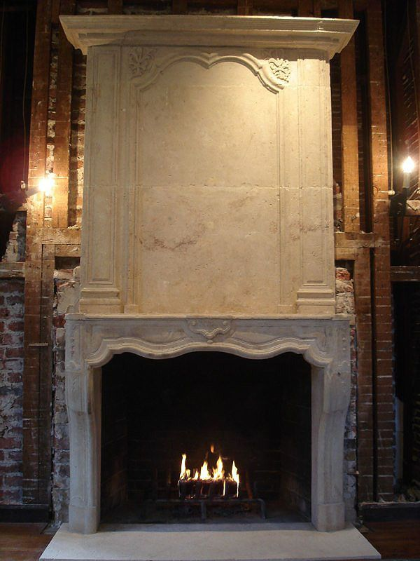 find this pin and more on french design fireplace mantels by - Stone Fireplace Surround