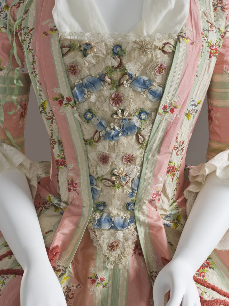 Detail stomacher, robe à la francaise, France, c. 1775, fabric: Spain. Cream green and pink striped silk embroidered with floral garlands, decorated with silk chenille, linen lining.