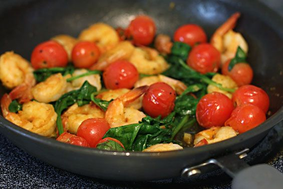 shrimp, tomato, spinach.  I think it would be great on some pasta.  Also you can add red pepper for a kick!
