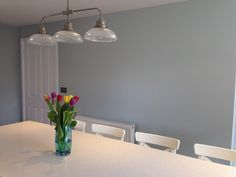 'Skylight' by Farrow and Ball for wall colour - a beautiful warm muted blue grey looks lovely against the white chairs and worktops #Farrow and Ball #Skylight #Kitchen