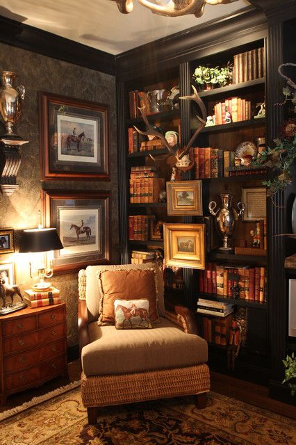 Love the chair, the chest and soft light with all the books. It is an elegant quiet place.