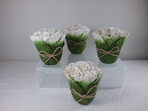 White Pretty Paper Rose Table Arrangements decorations 15cm dia x 15cm high All Brand new $10.00 each arrangement   I have been a florist for 35 years and love my job.  I have sold Bouquets and wedding arrangements to the most remote parts of Australia, especially where fresh flowers are not available, and for those who want an everlasting keepsake of their special day. My faux flowers are made of quality products.  The items listed are one offs   Postage listed is estimate only Availabl...