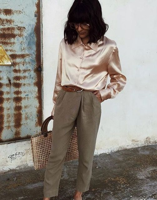 Chic nerdy look with a metallic blush blouse and army green trousers
