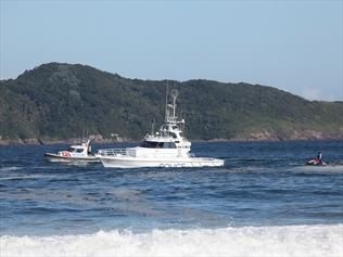 Search for missing NSW swimmer scaled back