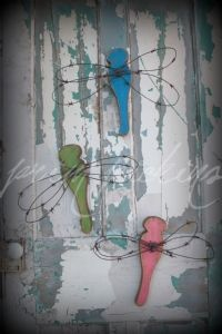 OMGosh i LOVE these so much. You can never have too many  handmade rusty barbed wire winged dragonflies!